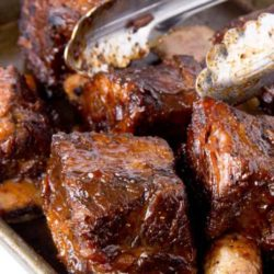 These Slow Cooker BBQ Short Ribs are so good there won't be leftovers! A little bit sweet with just the right amount of mustardy zest. If you're feeding a big crowd, double or triple the recipe.