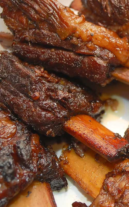 These flavorful braised short ribs perfectly illustrate how braised meat cooked on the bone can turn out succulent and tender enough to cut with a fork.
