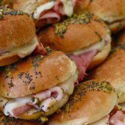 Recipe for Ham and Cheese Sliders - These sliders are completely addictive, thanks to the buttery and tangy sauce drizzled on top of them. Delish!