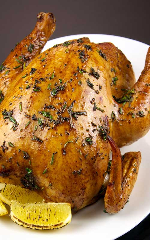 Recipe for Copycat Olive Garden Herb Roasted Chicken - This herb roasted chicken comes out perfectly moist and tender. Every bite is full of fresh vibrant flavors of rosemary, sage, thyme and lemon.