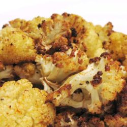 Recipe for Roasted Cauliflower - Blasting cauliflower florets in a hot oven concentrates their natural sweetness, turning them into something akin to vegetable candy.