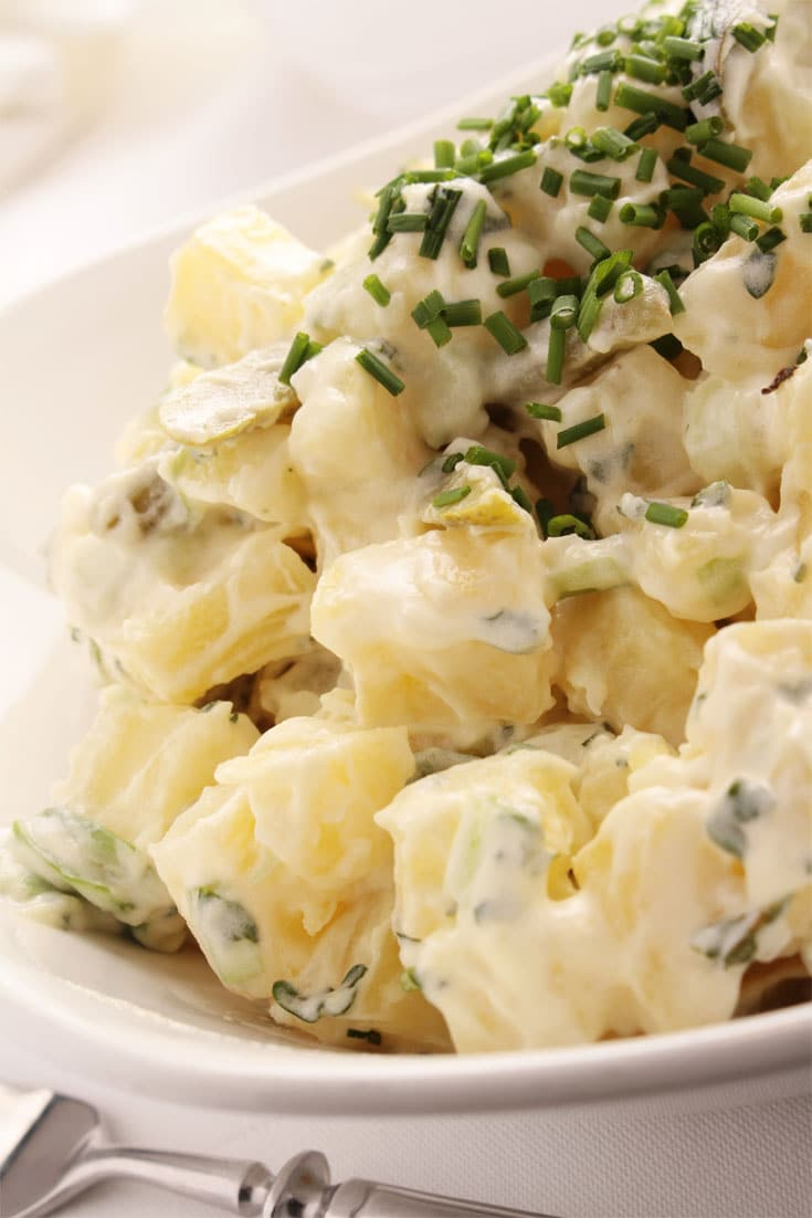 A super simple Classic Potato Salad with Chives that is always a hit at parties. The fresh chopped chives add a pop of color and delicious flavor. You can even add crushed garlic or finely chopped onion to take it up another notch! #potatoes #potatosalad #sidedish
