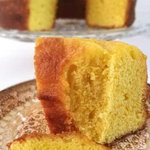Recipe forSimple Lemon Poundcake -You'll love that this simple lemon pound cake. It's moist and full of lemon flavor which means it is perfect for spring! It is so good that, the last time I made it, it didn't make it through the day!