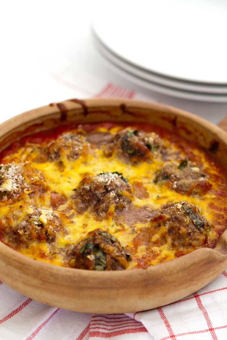Baked Cheesy Meatballs Recipe - Mouth watering baked cheesy meatballs make for a quick and easy way to enjoy meatballs that are cheesy and creamy but layered with the flavor.