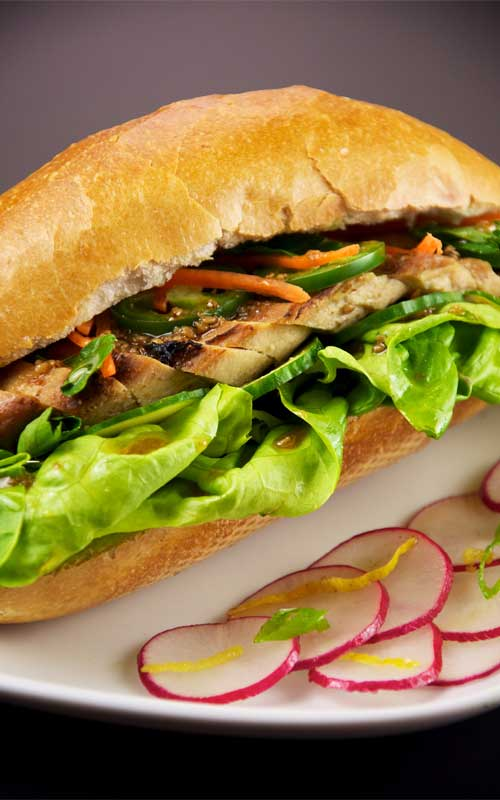 Recipe for Vietnamese Chicken Sandwich - Looking for the PERFECT sandwich? Give this homemade version of the ever so popular Banh Mi sandwich a try! This Vietnamese chicken sandwich is stuffed with tender sliced chicken, pickled veggies, and cilantro. It is sandwich heaven!
