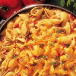 Recipe forCheesy Picante Beef Macaroni -This one-pot dinner is full of big flavors. Sauteed ground beef is stirred into shell pasta with a cheesy picante sauce to make a delicious hearty family dinner.