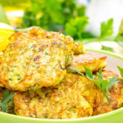Recipe for Zucchini Pancakes - Made with zucchini, these zucchini pancakes are a tasty change of pace from ordinary potato pancakes. Kick them up a bit by adding a little shredded onion to make them even more savory.