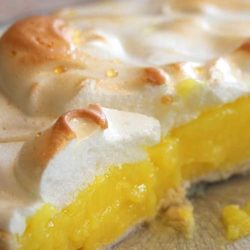 This lemon meringue pie is bursting with fresh lemon taste and a sweet, creamy real meringue topping.This is an old family recipe being passed down from Grandma to a new generation.
