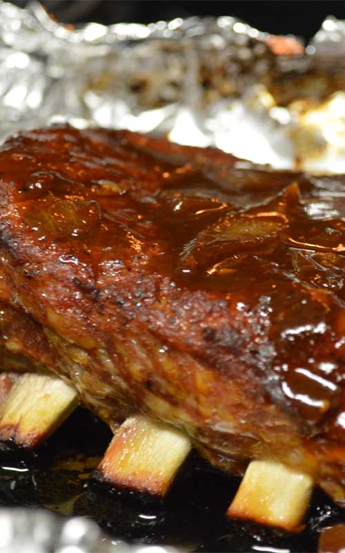 Recipe for Sweet & Sticky BBQ Ribs - It's really easy to get the low and slow smokehouse flavors of these Sweet & Sticky BBQ Ribs at home. With a spice rub, some time, and BBQ sauce, you will be devouring the best ribs in town.