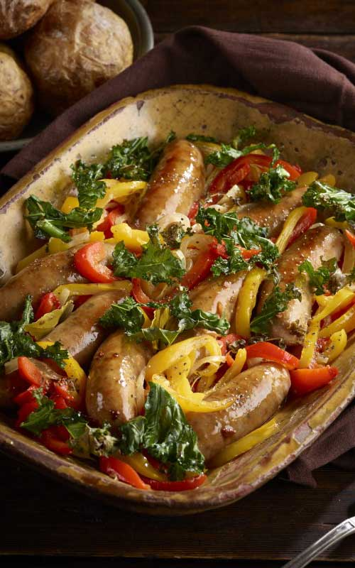 Close your eyes and imagine a visit to New York's vibrant Little Italy, home to dishes like this mouth watering Italian sausage stew with peppers and crispy kale
