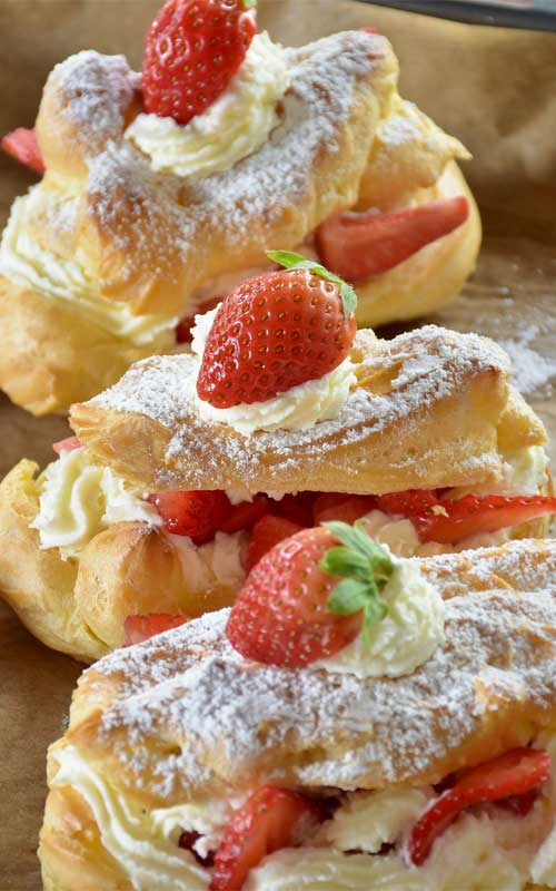 Eclairs are one of my favorites. These Strawberry Cheesecake Eclairs take that favorite and make it even more sinfully indulgent and decadent. You will not miss the chocolate with this version!
