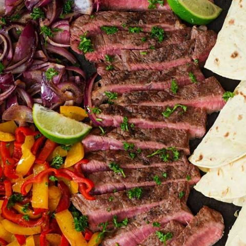 Enjoy your own Tex-Mex feast at home with this super-easy recipe for Margarita Steak Fajitas! Tequila and fresh lime juice are part of a marinade that gives these steak fajitas their bright flavor.