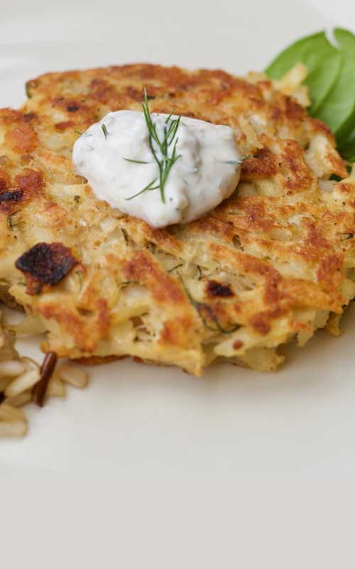 Frozen hash browns and flaked salmon come together for a twist on this traditional Swiss favorite, Salmon Rosti. We love the creamy dill sauce, but a little bit of ketchup is tasty too!