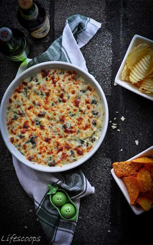 This decadent Baked 3 Cheese Spinach and Artichoke Dip recipe is loaded with three cheeses and baked to bubbly perfection. It always leaves my guests begging for more after scraping the bowl clean.